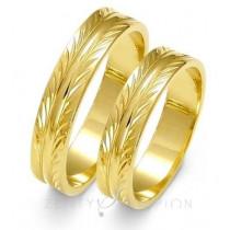 Jednobarwne obrączki ślubne złote z efektownym diamentowaniem
