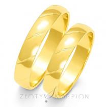Klasyczne półokrągłe obrączki ślubne z subtelnym zdobieniem