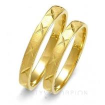 Obrączki ślubne z żółtego złota z finezyjnymi nacięciami