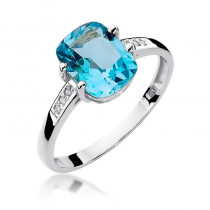 Okazały pierścionek z białego złota ozdobiony topazem i diamentami