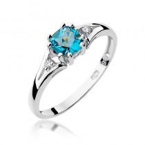 Śliczny pierścionek zaręczynowy z białego złota ozdobiony topazem i diamentami