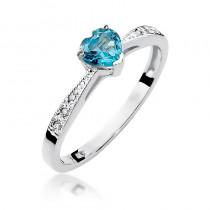 Śliczny pierścionek zaręczynowy z białego złota ozdobiony topazem w kształcie serca