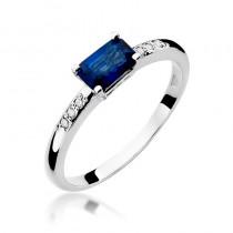 Elegancki pierścionek zaręczynowy z białego złota ozdobiony lśniącym szafirem i diamentami