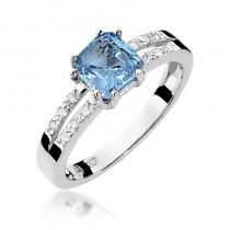 Lśniący pierścionek zaręczynowy z białego złota ozdobiony topazem i lśniącymi diamentami