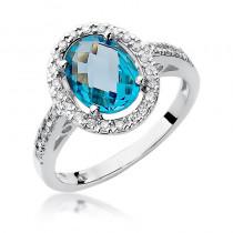 Ekstrawagancki pierścionek z białego złota ozdobiony okazałym topazem i diamentami