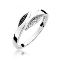 Niespotykany pierścionek z białego złota ozdobiony czarnymi i białym diamentami