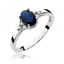 Złoty pierścionek zaręczynowy ozdobiony szafirem i diamentami