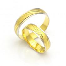 Złote obrączki ślubne z ukośnym grawerem