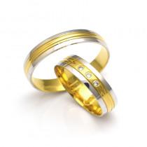 Złote obrączki ślubne z żółto-białego złota ozdobione nacięciami