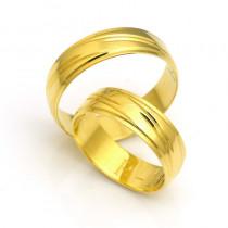Złote obrączki ślubne żółte ozdobione czarującym nacięciem