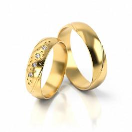 Obrączki ślubne z niezwykłym zdobieniem w postaci lśniących cyrkonii półokrągłe