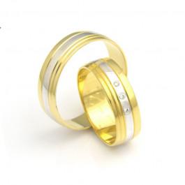 Wytworne złote obrączki ślubne dwukolorowe z intrygującym zdobieniem
